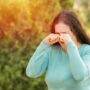 Woman Suffering From Eye Allergies